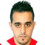 Malik Asselah headshot